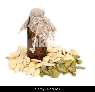 Pumpkin seeds oil. Isolated on white background. - Stock Photo
