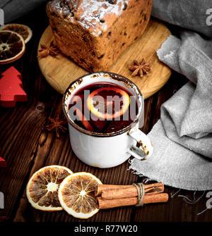 mulled wine in a white iron mug - Stock Photo