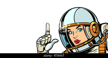 astronaut woman pointing finger up, isolate on white background - Stock Photo