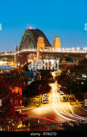 An overlooking view of Sydney Harbour Bridge during twilight - Stock Photo