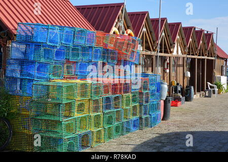 Colorful fishing baskets (covos) and fisherman's huts in the  fishing harbor of Santa Luzia, located near Tavira, Algarve, Portugal - Stock Photo