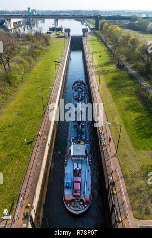 Cargo ship sails into lock Meidrich, connecting the Rhine-Herne canal to the Rhine, Europe's largest inland port, Ruhrort - Stock Photo