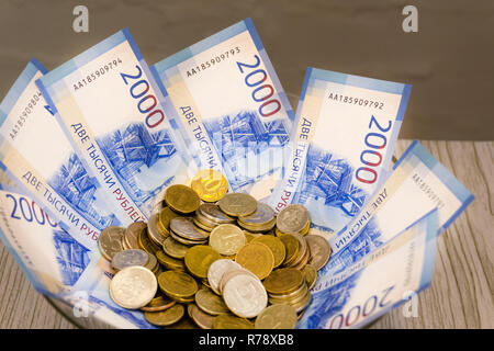 A lot of banknotes of different countries of the world, the difference in value stacked on the table with a fan - Stock Photo