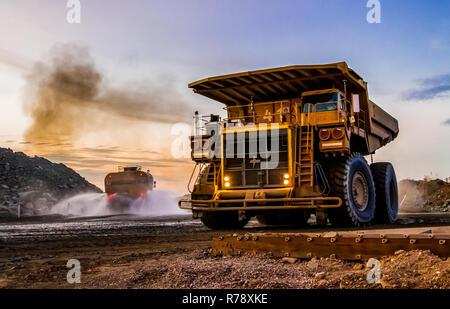Rustenburg, South Africa, October 15, 2012, Large Dump Trucks transporting Platinum ore for processing - Stock Photo