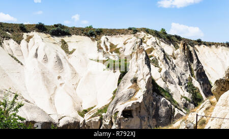 slope of valley with ancient caves near Goreme - Stock Photo
