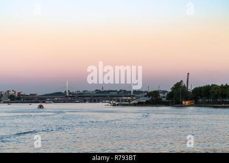 Golden Horn Metro Bridge in Istanbul in evening - Stock Photo