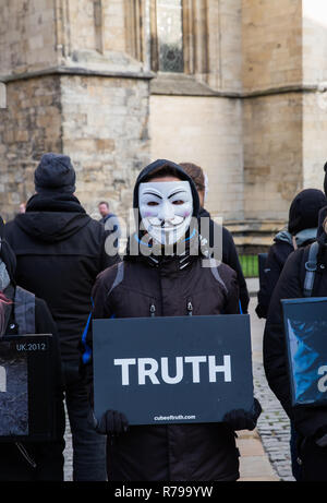 YORK, UK - DECEMBER 8, 2018.  Members of the Cube of Truth Vegan protest group in Guy Fawks masks and protesting about cruelty to animals. - Stock Photo