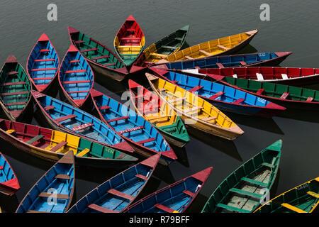 colorful rowboats on the phewa lake - Stock Photo