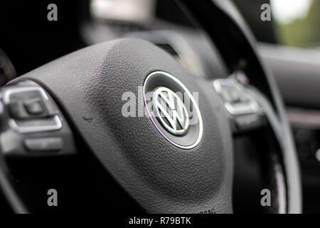 VW Steering Wheel MPV/SUV/Saloon/Estate/Coupe. German Luxury vehicle logo. VW emission scandal. German engineering - Stock Photo