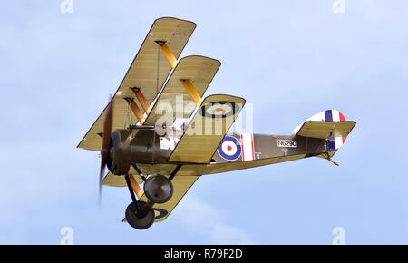 Sopwith Triplane flying at the 2018 Military Pageant Airshow at Old Warden - Stock Photo