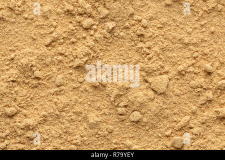 Ginger powder ground full frame image background, view directly from above, rough uneven surface - Stock Photo