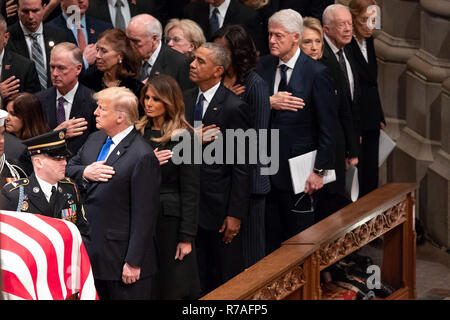 WASHINGTON, DC - WEEK OF DECEMBER 1, 2018: President Donald Trump - A Tribute to 41 - President George H. W Bush Dead At 94 - President Donald J. Trump and First Lady Melania Trump, joined by former President Barack Obama and First Lady Michelle Obama, former President Bill Clinton and First Lady Hillary Clinton, and former President Jimmy Carter and First Lady Rosalynn Carter, watch as the casket of former President George H.W. Bush arrives to the funeral service Wednesday, Dec. 5, 2018, at the Washington National Cathedral in Washington, D.C.  People:  President Donald J. Trump and First Lad - Stock Photo