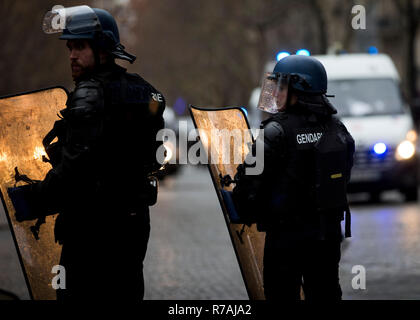 Paris, France. 8th Dec 2018. CRS officers seen near the Arc De Triomphe during a 'Yellow Vest' protest in Paris. Without any political affiliation, the 'Yellow Vest' movement rallies in various cities in France this saturday against taxes and rising fuel prices. Credit: SOPA Images Limited/Alamy Live News - Stock Photo