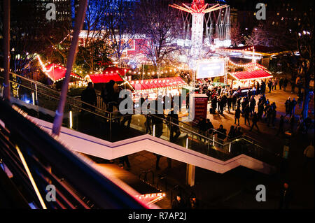 London, UK. 7th Dec, 2018. Crowds visit the 'Underbelly' Christmas market on the South Bank of the River Thames in London.Christmas shopping season is in full swing in London with just over two weeks to go before the 25th, and with retailers hoping for strong sales to finish a year that has seen many household names fall into serious financial difficulties. Credit: David Cliff/SOPA Images/ZUMA Wire/Alamy Live News - Stock Photo