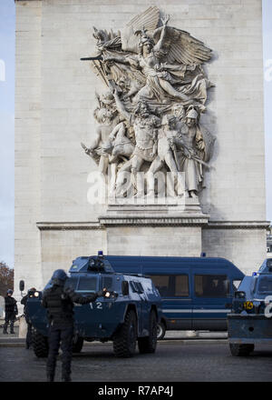 Paris, France. 8th Dec, 2018. Armored vehicles seen arriving at the Arc De Triomphe during a 'Yellow Vest' protest in Paris.Without any political affiliation, the ''˜Yellow Vest' movement rallies in various cities in France this saturday against taxes and rising fuel prices. Credit: Sathiri Kelpa/SOPA Images/ZUMA Wire/Alamy Live News - Stock Photo