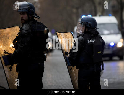 Paris, France. 8th Dec, 2018. CRS officers seen near the Arc De Triomphe during a 'Yellow Vest' protest in Paris.Without any political affiliation, the ''˜Yellow Vest' movement rallies in various cities in France this saturday against taxes and rising fuel prices. Credit: Sathiri Kelpa/SOPA Images/ZUMA Wire/Alamy Live News - Stock Photo