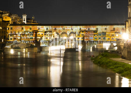 Florence, Italy. 8th Dec 2018. The Christmas lights are lit in Florence. The Ponte Vecchio in Florence is illuminated by a videomapping that projects the genius of Leonardo da Vinci transforming the bridge into a lightshow .Florence 8th Dicember © Michela Goretti /  Alamy Live News - Stock Photo