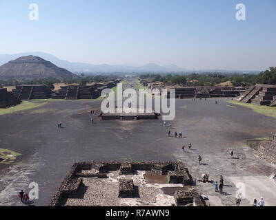 Famous Avenue of the Dead and pyramid of the Sun on left at Teotihuacan ruins near Mexico city landscape - Stock Photo