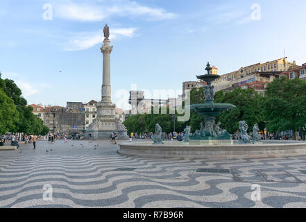 LISBON, PORTUGAL - August 30, 2018: Rossio Square with  Column of Pedro IV. The terrace and walkway of the Santa Justa Lift, with upper level kiosk - Stock Photo