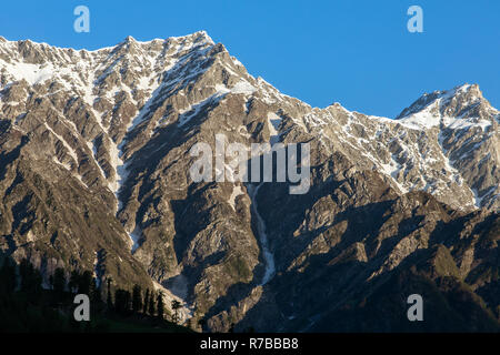 View of the Great Himalaya Range from the Kullu valley in Himachal Pradesh state, India. Landscape of snow covered mountains - Stock Photo