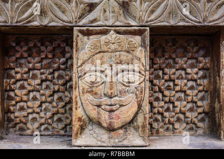 Vashisht, India - May 27, 2017: Traditional wooden carving on the hindu temple in Vashisht village in Kullu valley, Himachal Pradesh, India - Stock Photo
