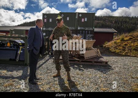 U.S. Marine Maj. Gen. Niel Nelson, commander of U.S. Marine Corps Forces Europe and Africa (MARFOREURAF), discusses the Marine Corps Prepositioning Program Norway (MCPP-N), with Lyle Layher, MARFOREURAF's prepositioning officer, at an assembly area in Norway, May 9, 2017. By storing equipment in Norwegian caves, MCPP-N eliminates the need to deploy equipment from the United States for contingency operations which decreases the time required to prepare units. - Stock Photo