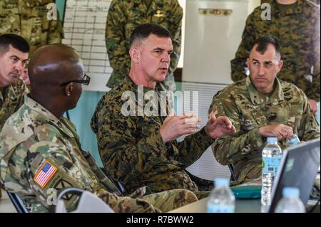 U S Army Col David Foley Commander 1 2 Stryker Brigade Combat Team Presents A Coin To Royal
