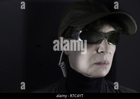 The very severe face of a female cop from secret services. - Stock Photo