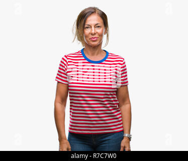 Middle age senior hispanic woman over isolated background with a happy and cool smile on face. Lucky person. - Stock Photo