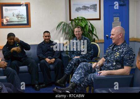 RIJEKA, Croatia (May 10, 2017) Vice Adm. Christopher Grady, commander, U.S. 6th Fleet, meets with the Blue Ridge-class command and control ship USS Mount Whitney (LCC 20) wardroom aboard the ship at Viktor Lenac shipyard in Rijeka, Croatia, May 10, 2017. Mount Whitney, the U.S. 6th Fleet command and control ship, forward deployed to Gaeta, Italy, operates with a combined crew of U.S. Navy Sailors and Military Sealift Command civil service mariners. - Stock Photo