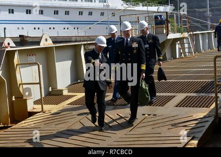 RIJEKA, Croatia (May 10, 2017) Cmdr. Albert Benoit, executive officer of the Blue Ridge-class command and control ship USS Mount Whitney (LCC 20), escorts Vice Adm. Christopher Grady, commander of U.S. 6th Fleet, to the ship at Viktor Lenac shipyard in Rijeka, Croatia. Mount Whitney, the U.S. 6th Fleet command and control ship, is forward deployed to Gaeta, Italy, operating with a combined crew of U.S. Navy Sailors and Military Sealift Command civil service mariners. - Stock Photo