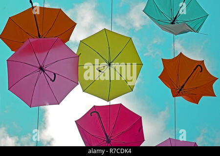 colorful umbrellas on a background of clouds. View from the bottom to the sky Stock Photo