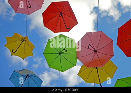 colorful umbrellas against the blue sky and clouds. View of the sky in Jerusalem - Stock Photo