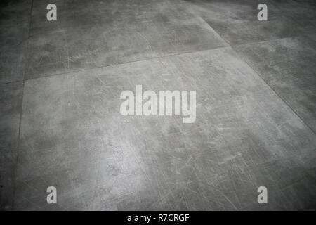 A grungy old concrete texture in gray color - Stock Photo