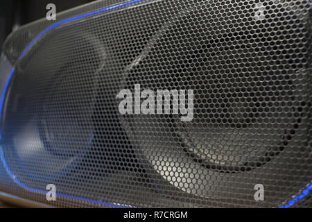 Loudspeaker grid texture in dark colors with round texture - Stock Photo