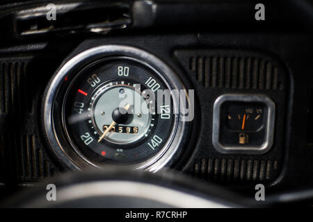 Old car dashboard and instrument claster on dark interior - Stock Photo