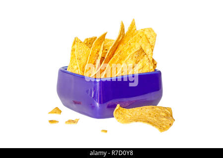 Corn chips nachos in a blue ceramic bowl on a white background. Side view. Isolated - Stock Photo