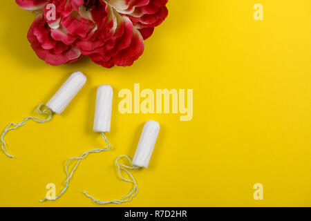 Cotton tampon. Womens comfort, hygiene and protection. - Stock Photo