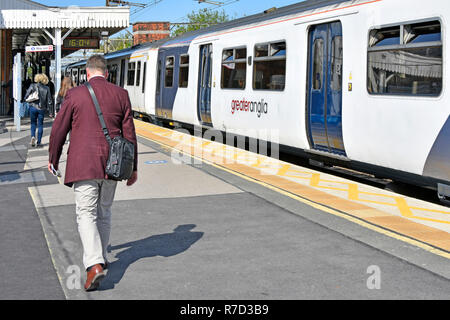 Passengers walking along platform after travelling on Greater Anglia commuter service from London train departures Shenfield railway station Essex UK - Stock Photo