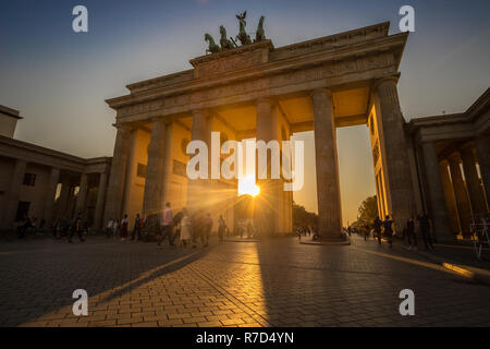 Sunset in Brandenburg gate of Berlin - Stock Photo