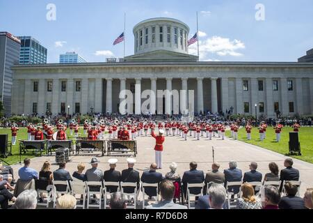 """The Commandant's Own"" the U.S. Marine Drum & Bugle Corps perform for guests during a Battle Color Ceremony at the Ohio Statehouse, Columbus, Ohio, May 16, 2017. The Marine Corps Battle Color Detachment was invited and hosted by the Speaker of the Ohio House of Representatives, Clifford A. Rosenberger, to tour the Statehouse and perform for members of the House of Representatives and the city of Columbus. In December, the Barracks provided Marines in supporting the public viewing of former Marine, Senator and astronaut, John Glenn, at the Statehouse. In attendance at the Battle Color Ceremony  - Stock Photo"