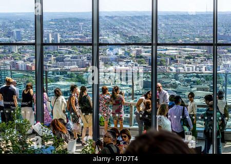 Tourists visiting Sky Gardens in London, panorama of London seen from above. 03.07.2018 - Stock Photo