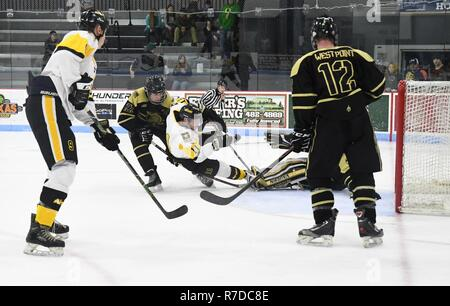 First Lt. Josh Roberts (#11), with 1st Battalion, 23rd Infantry Regiment, at Joint Base Lewis-McChord, Washington, recorded two goals for the All Army Hockey Team during a scrimmage Dec. 1 against the West Point Club Hockey Team at Watertown Municipal Arena. - Stock Photo