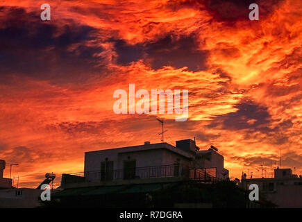 A very dramatic red sky over the city. - Stock Photo