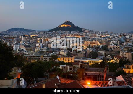 View of Athens dominated by Lycabettus hill. Image taken from Anafiotika in the old Town - Stock Photo