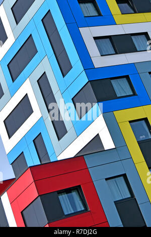 Abstract building architecture using colour shapes on colourful modern student accommodation architectural geometric pattern corner detail England UK - Stock Photo