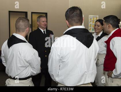 SPOKANE, Washington (May 16, 2017) Rear Adm. Kevin Kovacich, from Spokane, Director of Plans and Policy (J5), U.S. Cyber Command, talks to Sailors assigned to USS Constitution during an event at Spokane Community College for Spokane Navy Week. Since 2005, the Navy Week program has served as the Navy's principal outreach effort into areas of the country without a significant Navy presence, with 195 Navy Weeks held in 71 different U.S. cities.  The program is designed to help Americans understand that their Navy is deployed around the world, around the clock, ready to defend America at all times - Stock Photo