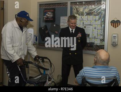 SPOKANE, Washington (May 16, 2017) Rear Adm. Kevin Kovacich, from Spokane, Director of Plans and Policy (J5), U.S. Cyber Command, meets with residents of the Spokane Veterans Home during a Spokane Navy Week event. Since 2005, the Navy Week program has served as the Navy's principal outreach effort into areas of the country without a significant Navy presence, with 195 Navy Weeks held in 71 different U.S. cities.  The program is designed to help Americans understand that their Navy is deployed around the world, around the clock, ready to defend America at all times. - Stock Photo