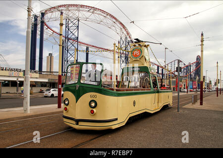 Blackpool open top tram in front of Pleasure Beach - Stock Photo