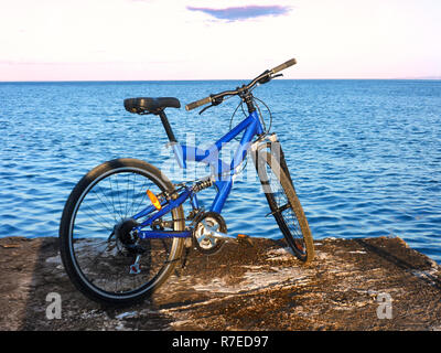 Blue mountain bike at the end of pier. Rafina city , Greece - Stock Photo